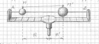 Apparecchio di rotazione con sfere di masse diverse